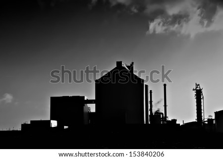 Silhouette of a factory - stock photo