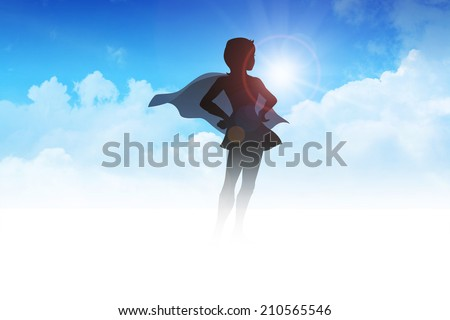 Silhouette of a female figure with superhero suit on clouds - stock photo