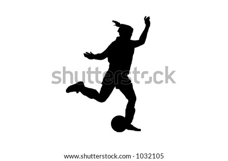 Silhouette of a female soccer player preparing to strike the ball - stock photo