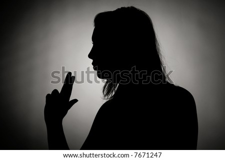 Silhouette of a girl blowing a pipe of a gun (after a succesful shooting) - stock photo