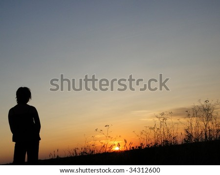 Silhouette of a girl in the Oklahoma sunset - stock photo
