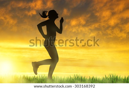Silhouette of a girl running at sunset