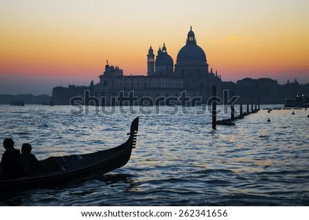 silhouette of a gondola by Venice coastline, Italy - stock photo