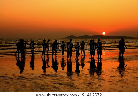 Silhouette of a group of people at the Koh Samet beach in the evening, Rayong, Thailand, asia,  - stock photo