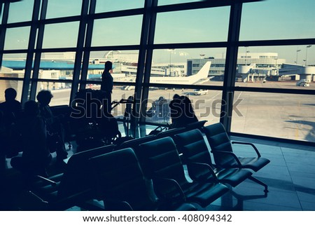 silhouette of a group of people in an airport waiting hall. travel business concept