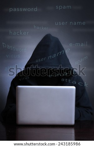 Silhouette of a hacker looking in monitor, Computer hacker - Male thief stealing data from laptop - stock photo