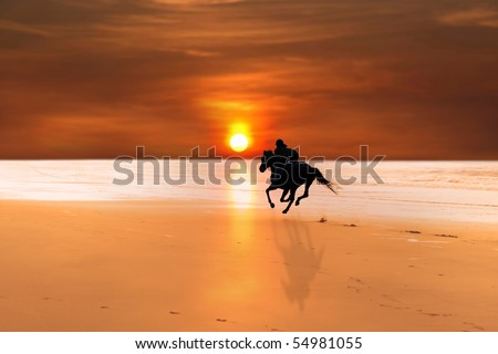 silhouette of a horse and rider galloping on ballybunion beach at sunset in kerry ireland - stock photo