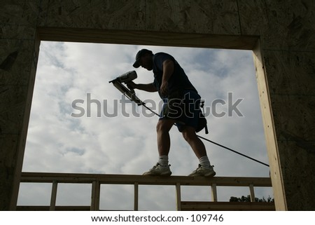 Silhouette of a House Builder - stock photo