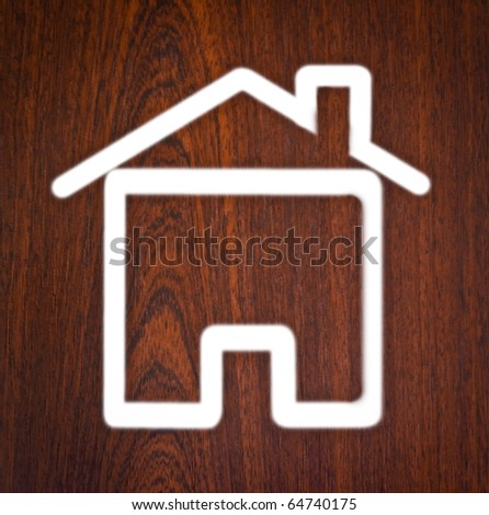 Silhouette of a house on a wooden texture. - stock photo