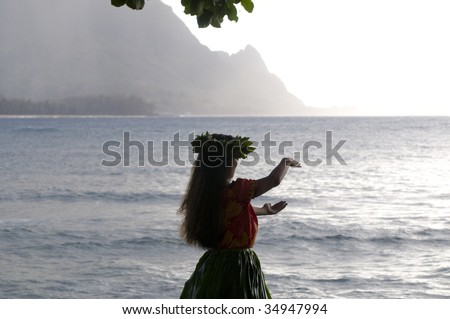 silhouette of a hula dancer dancing on the beach in Kauai at sunset - stock photo