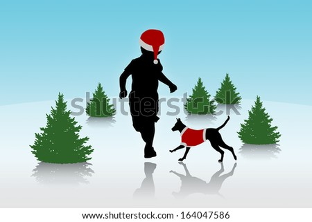 silhouette of a little boy running in a red hat with his dog on a top of a snow hill with lots of christmas trees - stock photo