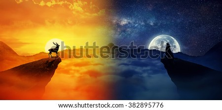 Silhouette of a lonely deer and a howling wolf standing on different cliffs against. Wild life landscape scene screen saver. Day vs Night, Moon vs Sun - stock photo