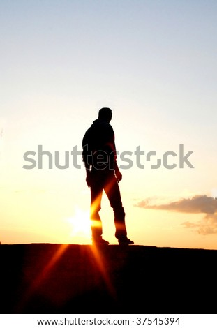 Silhouette of a lonely man in the sunset