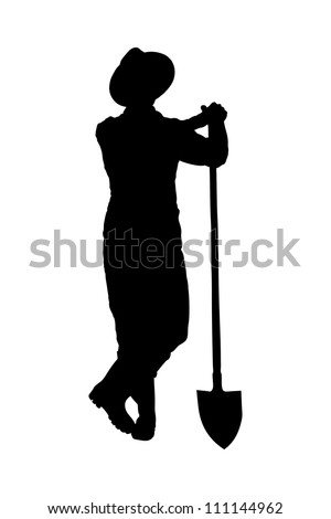 Silhouette of a male farmer holding a shovel isolated on white background - stock photo
