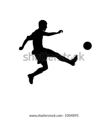 Silhouette of a male soccer player taking a shot - stock photo