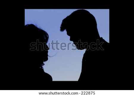 Silhouette of a Man and a Woman getting married - stock photo