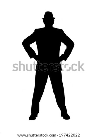 Silhouette of a man in a suit and hat as an authority figure with his hands on his hips as though being stubborn or angry isolated on white. - stock photo