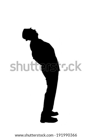 Silhouette of a man in a suit and hat bending over backwards to look up to  the sky isolated on white. - stock photo