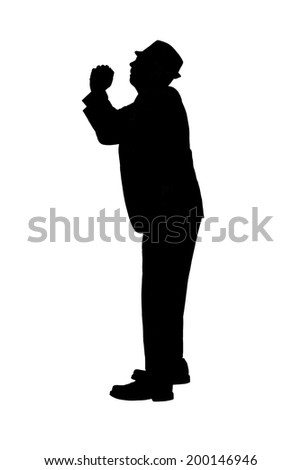 Silhouette of a man in a suit and hat with hands clasped and looking up as if pleading for mercy or forgiveness or for praying isolated on white. - stock photo