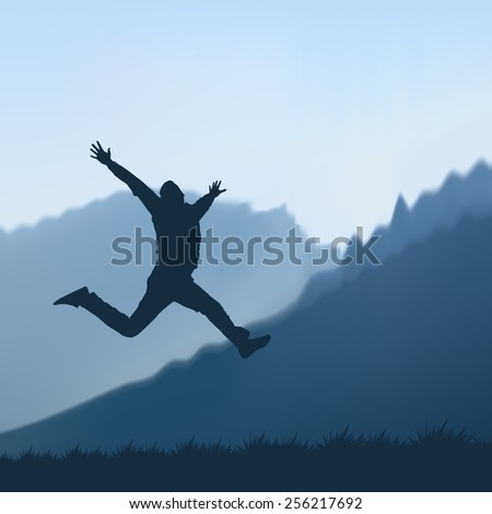 Silhouette of a man jumping in the mountains