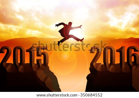Silhouette of a man jumps from 2015 to 2016 - stock photo