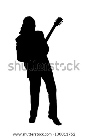 silhouette of a man playing guitar - stock photo