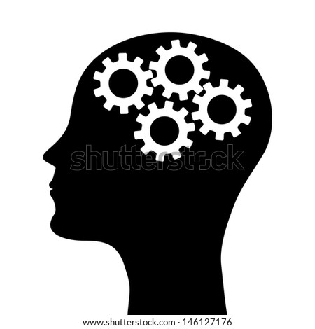 silhouette of a man's head with a picture of the mechanism - stock photo