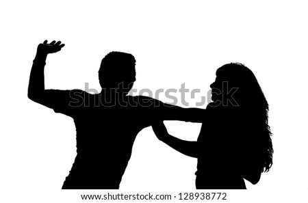 Silhouette of a man slapping a woman - stock photo