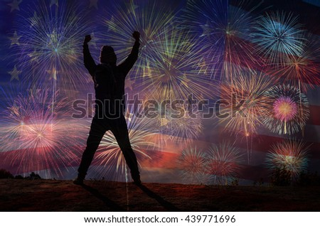 silhouette of a man who show hands over the Multicolor Fireworks Celebrate over the United state of America USA flag background, Independence day concept