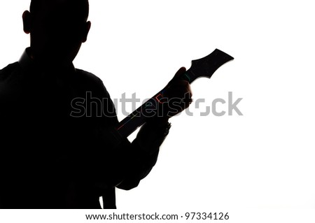 Silhouette of a man with guitar against white background