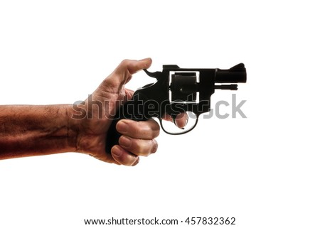 Silhouette of a mans hand with a handgun - stock photo