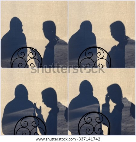 Silhouette of a Men in discussion - stock photo