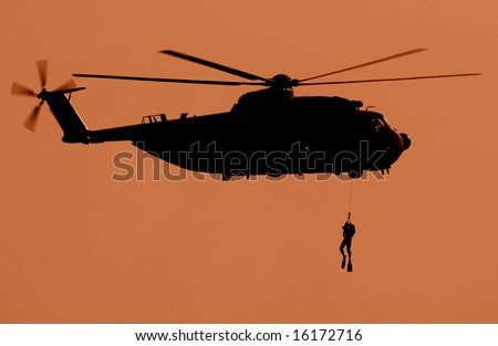 Silhouette of a military helicopter during a sea rescue exhibition.