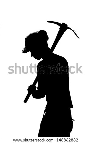 silhouette of a Mine worker with helmet and pick - stock photo