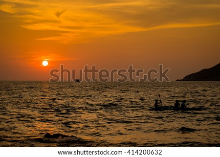 Silhouette of a people rowing in the canoe sunset , phuket island , Thailand - stock photo