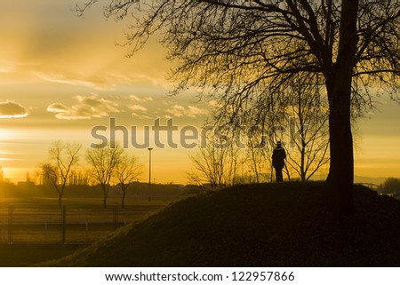 Silhouette of a person sun gazing at sunset