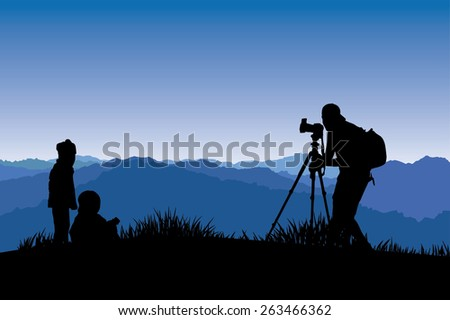 Silhouette of a photographer who shooting a sunset on the mountain