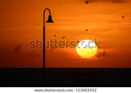 Silhouette of a pier at sunset, Key West, Monroe County, Florida, USA - stock photo
