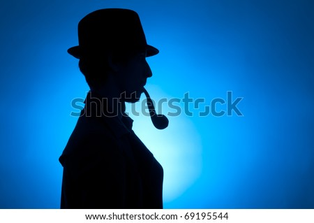 Silhouette of a private detective isolated on a blue background - stock photo