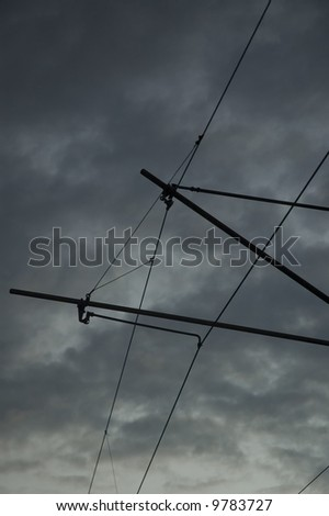 silhouette of a railway power line with sky as a background
