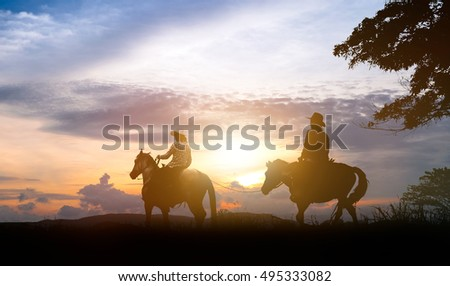 silhouette of a rider on a horse.Three cowboys silhouetted against a dawn sky. Montana horse ranch