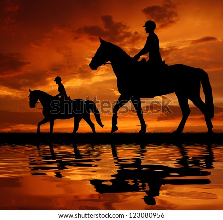 silhouette of a riders on a horse - stock photo