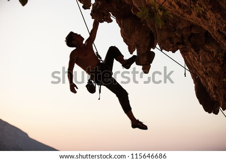 Silhouette of a rock climber