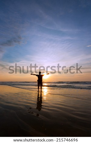 Silhouette of a single man at sunset - stock photo