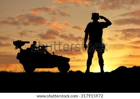Silhouette of a soldier and a combat vehicle Humvee at sunset