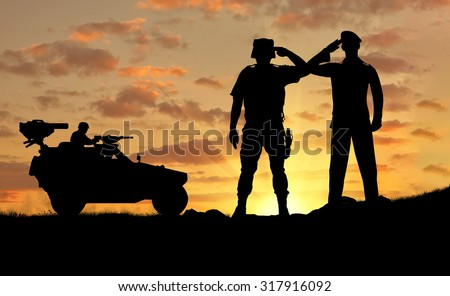 Silhouette of a soldier and the commander of a combat vehicle Humvee at sunset
