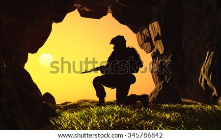 Silhouette of a soldier in a cave. - stock photo