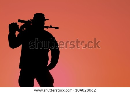 silhouette of a soldier with a background red sunset