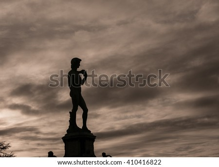 silhouette of a statue  - stock photo