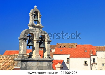 Silhouette of a stone bell tower above the old town of Dubrovnik, Croatia - stock photo